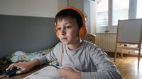Elementary aged boy on laptop distance learning at home