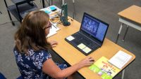 A California elementary school teacher takes attendance of her virtual distance learning class