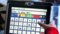 Child uses Dynavox alternative communication device