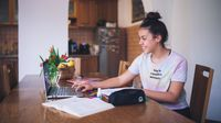 Teenage girl participates in virtual learning at home