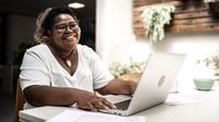 Teacher participates in a video chat at home
