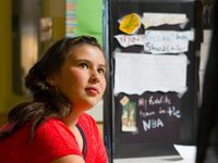 photo of a student in front of a presentation board about genius hour