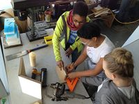 A photo of 3 high school girls working in the makerspace.