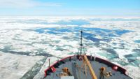 Standing on a boat overlooking a sea of ice