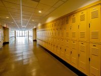 School corridor with yellow lockers lining both sides