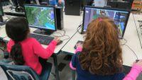 Kids explore Minecraft in a class.