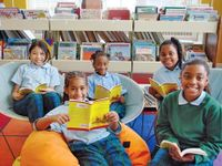 Kids from the New Orleans Book Club in the library