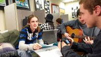 Boys playing guitar and singing