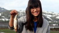 Girl from Alaska's Chugach School District holding up a fish