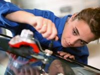 Girl working on an automobile