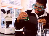 A photo of a high school student working in a chemistry lab.