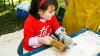Photo of girl doing woodworking