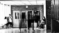 Image of students walking in a school hallway