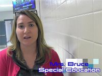 A female teacher standing in a school hallway. The words Mrs. Bruce and Special Education are imposed on the photo.