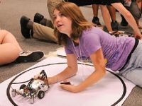 photo of a student working on a robotics project