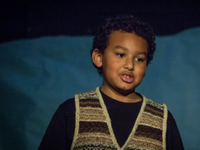 photo of a boy speaking