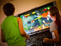 photo of two kids playing a video game