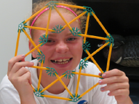 photo of a young woman with a spirograph-like toy