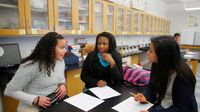 High school students work in a group in science class