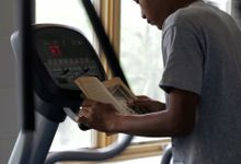 A student is doing an excercise while he is reading.