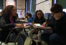 Students are discussing about their group work in a classroom