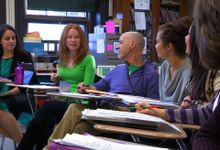 Teachers are having a group meeting.