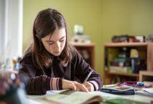 Adolescent girl doing homework.
