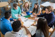 A group of high school students engaged in discussion