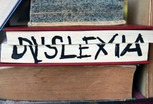 """The word """"dyslexia"""" written across the pages of a closed book"""
