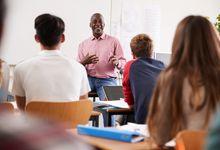 Administrator teaching a high school class