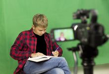 A student shapes a story with a script and video camera