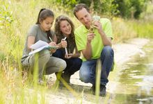 Teacher and students learn about climate outdoors
