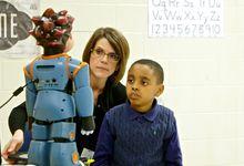 Jordan works with Milo the robot.