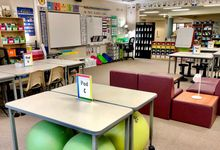 The author's flexible classroom, with many different seating arrangements such as chairs, couches, yoga balls, and stools