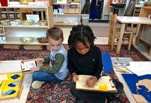 Two students work on activities at Latta Elementary School.