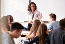 A history teacher addressing a high school class