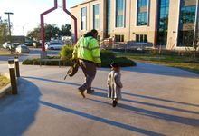 A father and his daughter walk outside of Educare.