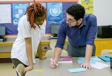 Kareem helping a student.