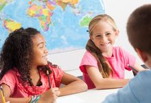 Elementary students having a small group discussion in class