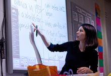 Teacher teaching from interactive whiteboard