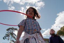 Girls play with hula hoops at Wooranna Park.