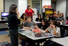 Two teachers instructing a high school class