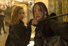 Hunger Games movie still showing the character Katniss Everdeen shooting an arrow