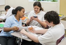 High school students working together in math class
