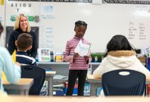 Elementary school student giving a presentation to her class