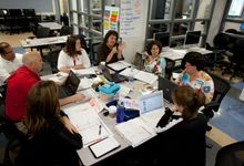 Teachers meeting in a classroom