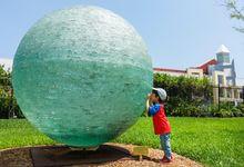 Child exploring in a sculpture garden