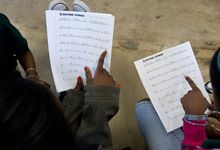 Two students reading sheet music