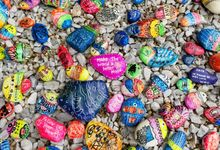 Assorted rocks painted with messages of kindness