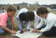 Elementary school students study may outside classroom